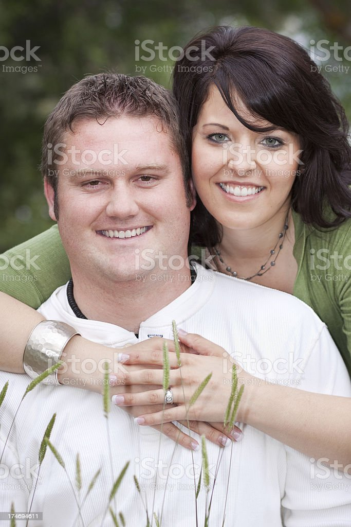 Outdoor Portrait of Smiling Young Man and Woman Embracing royalty-free stock photo