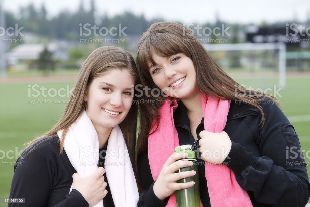 Outdoor portrait of two young women ready to exercise royalty-free stock photo