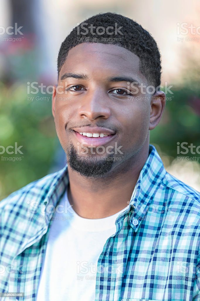 Outdoor portrait of young African American man stock photo