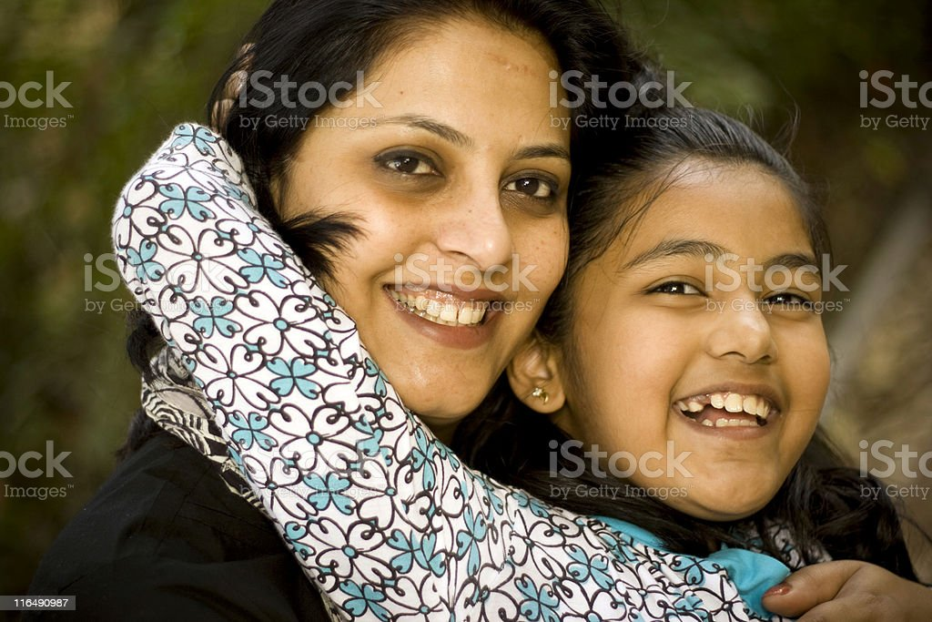Outdoor portrait of young cheerful attractive Indian mother and daughter royalty-free stock photo