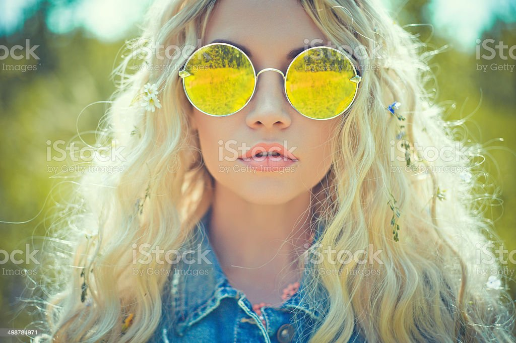 Outdoor portrait of young hippie woman stock photo