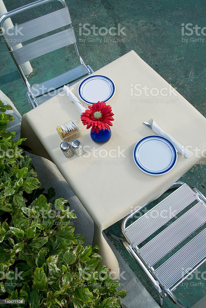 Outdoor restaturant tables in sun series 01 royalty-free stock photo