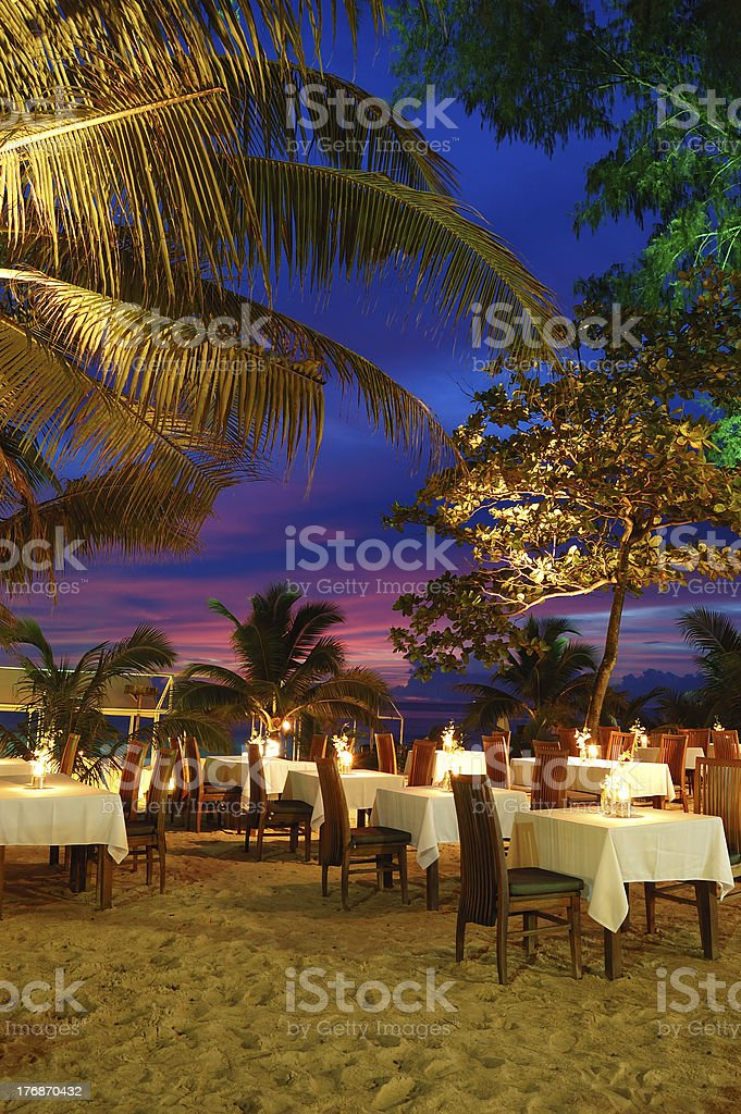 Outdoor restaurant at the beach during sunset, Phuket, Thailand royalty-free stock photo