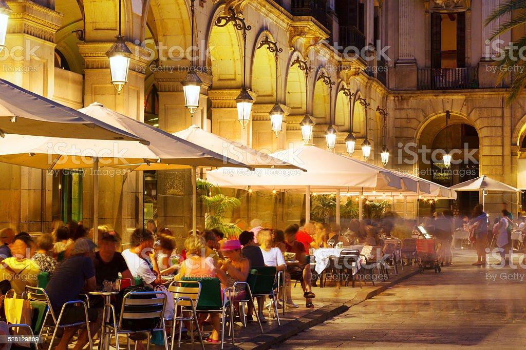 Outdoor restaurants at Placa Reial in  night. Barcelona stock photo