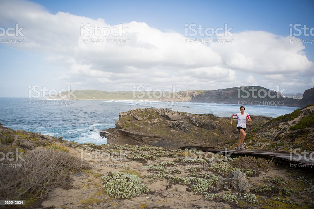 Outdoor running adventure by the sea stock photo