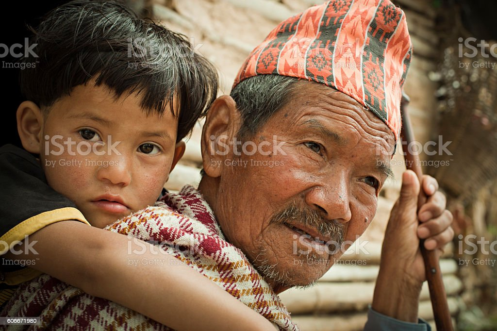 Outdoor rural image of grandchild on grandfather's piggyback. stock photo