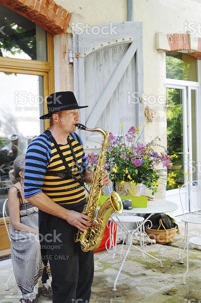 Outdoor saxophonist in Provencal festival stock photo