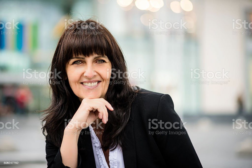Outdoor senior business woman portrait stock photo
