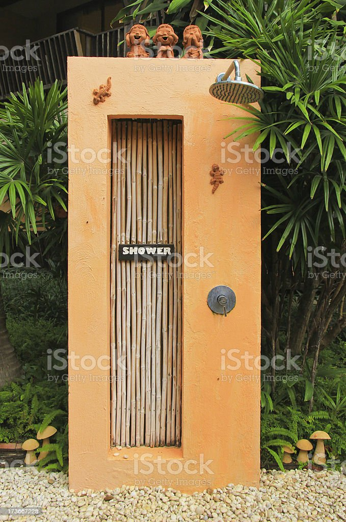 Outdoor shower near swimming pool in tropical style royalty-free stock photo