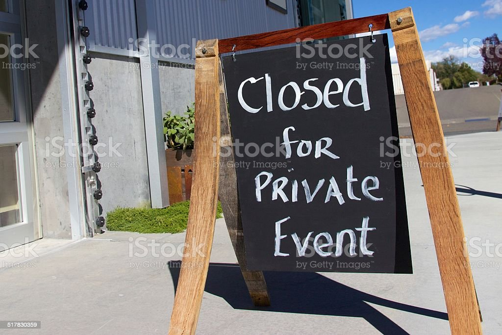 Outdoor sign reading 'closed for private event' stock photo