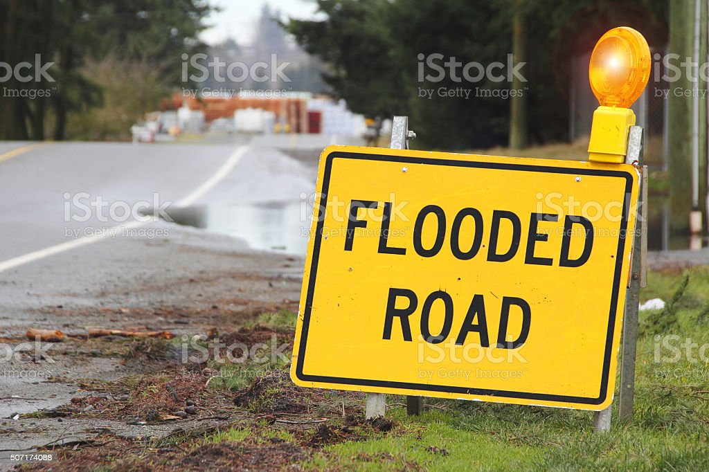 Outdoor Sign Stating Flooded Road stock photo