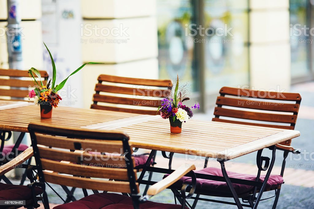 Outdoor street cafe tables ready for service stock photo