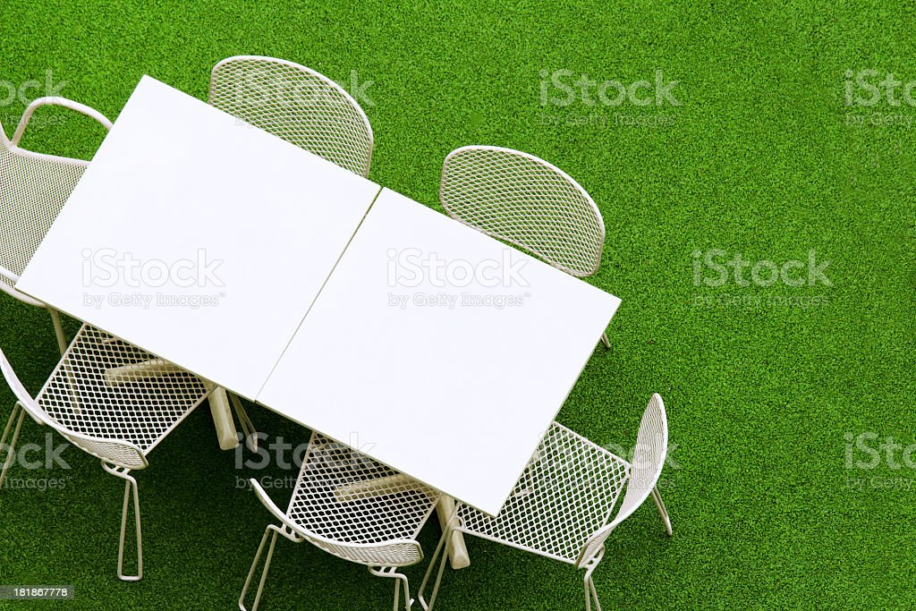 Outdoor table and chair on the grassland royalty-free stock photo