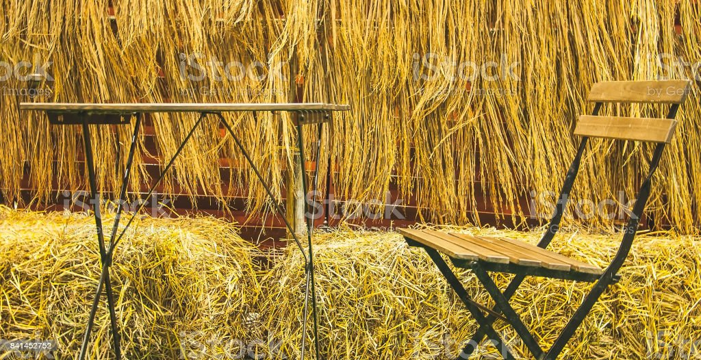 Outdoor tables and chairs outdoor with rice straw background stock photo
