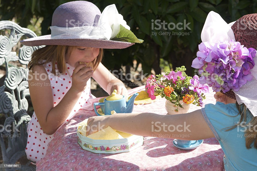 Outdoor Tea Party - Little Girls with Fancy Hats stock photo