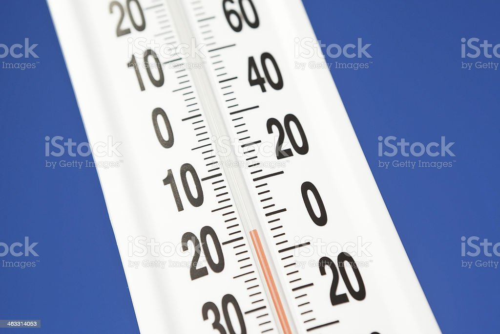 Outdoor Thermometer against Blue Sky Registers Below Zero stock photo