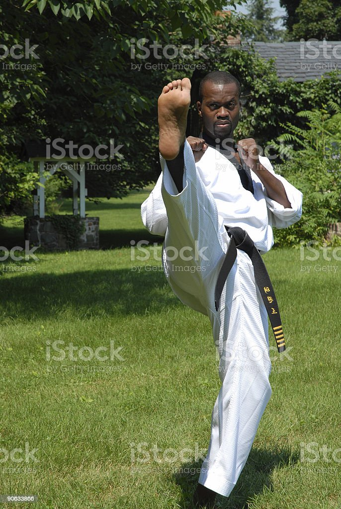 Outdoor training (front kick) stock photo