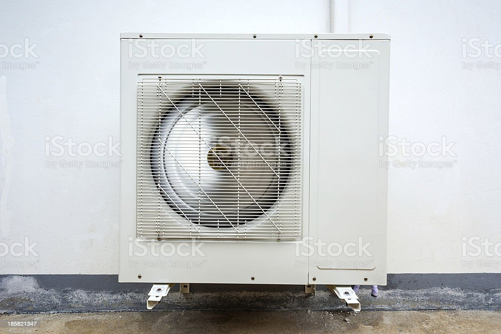 Outdoor Unit of Air Conditioner on the Wall stock photo