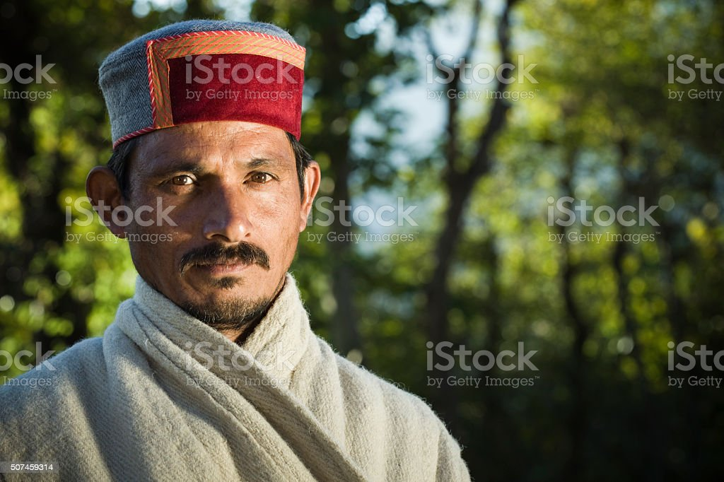 Outdoor village man of Himachal Pradesh in traditional dress. stock photo