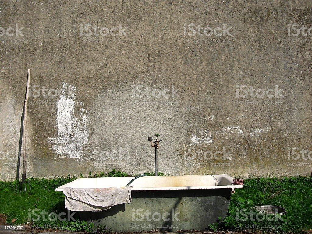 Outdoor Washing Arrangements – Grunge bathtub stock photo