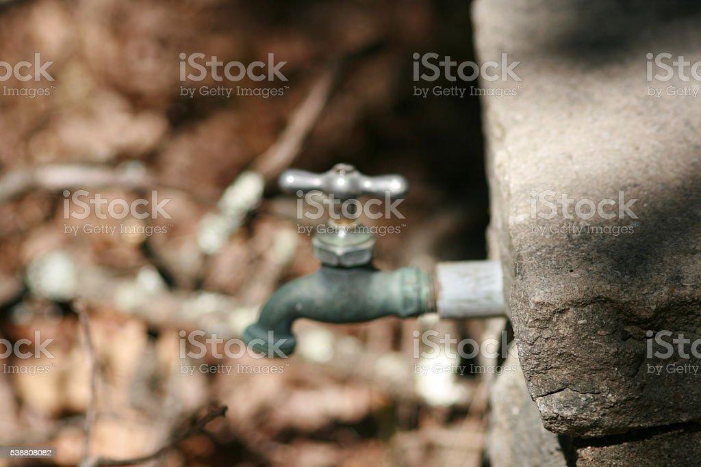 outdoor water spigot stock photo