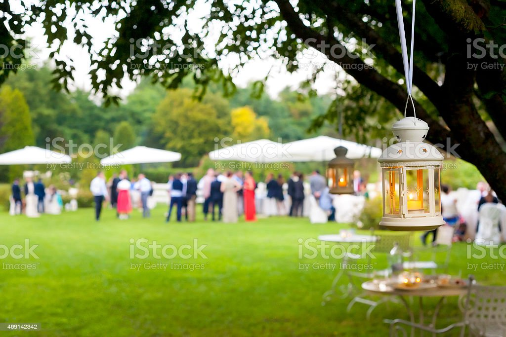 Outdoor wedding reception with green scenery stock photo