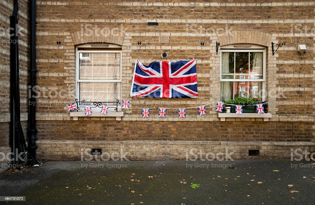 Outdoor window with hanging British flags stock photo
