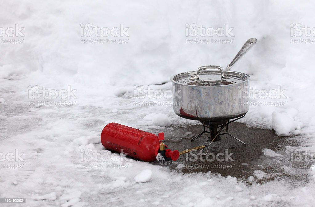 Outdoor winter cooking - surviving a blackout with backpacking stove stock photo