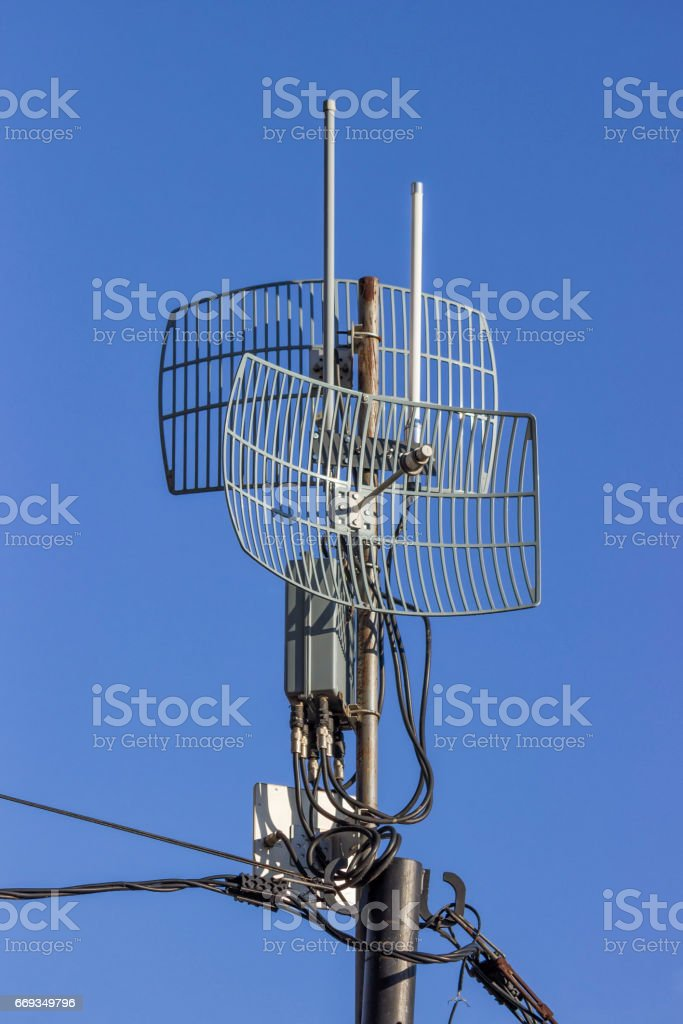 Outdoor wireless parabolic directional antennas on pole stock photo