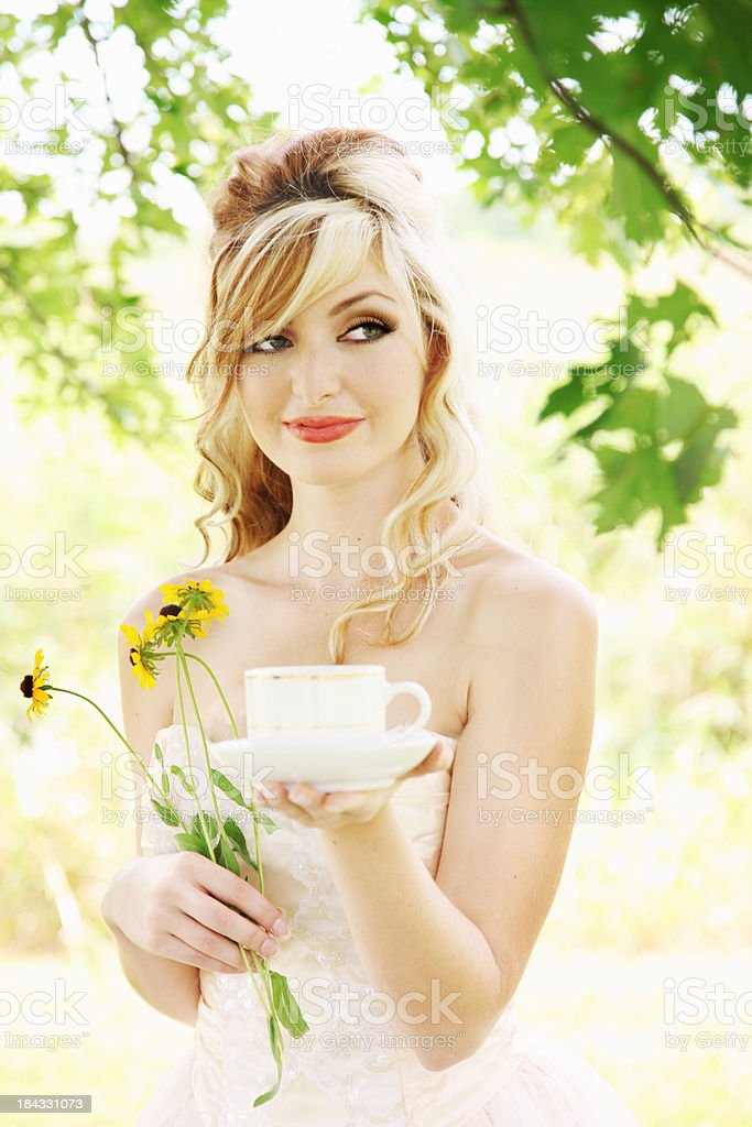 Outdoor woman with teacup and flowers royalty-free stock photo