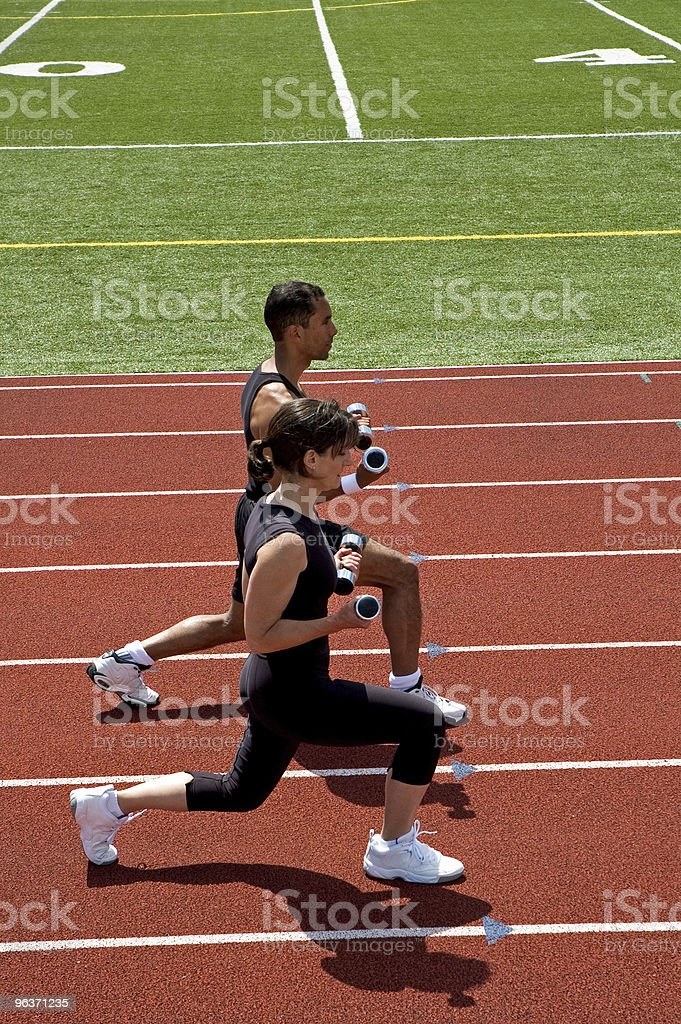 Outdoor Work Out on Race Track - Lunges With Weights royalty-free stock photo