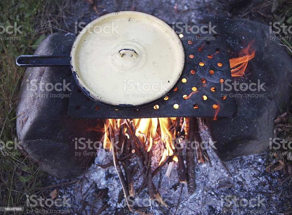 Outdoors cooked stew boiling on the fire royalty-free stock photo