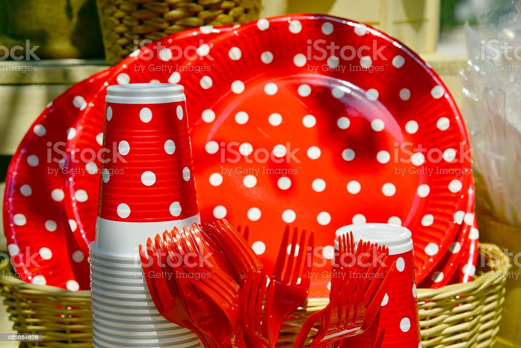 Outdoors kitchen setup catering plastic plates cups red points stock photo