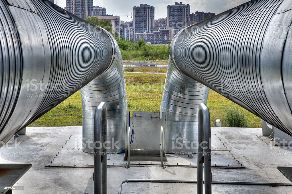 outdoors metal hot water pipeline, steel pipe stock photo
