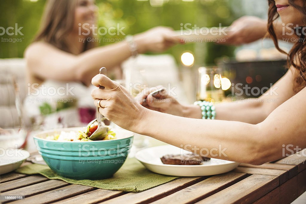 Outdoors on patio eating stock photo