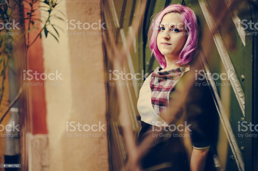 Outdoors portrait of a pink haired teenage girl stock photo