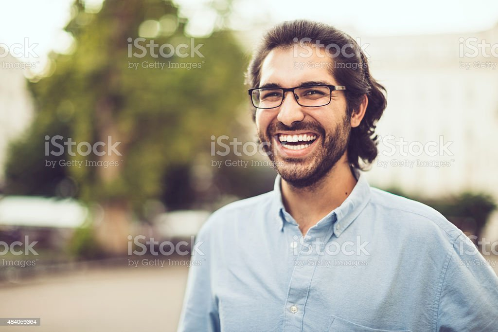 Outdoors portrait of a young man stock photo
