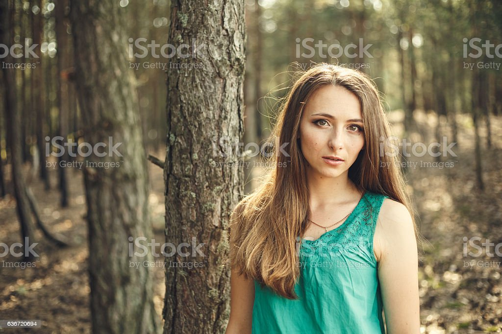 Outdoors portrait of beautiful young woman stock photo