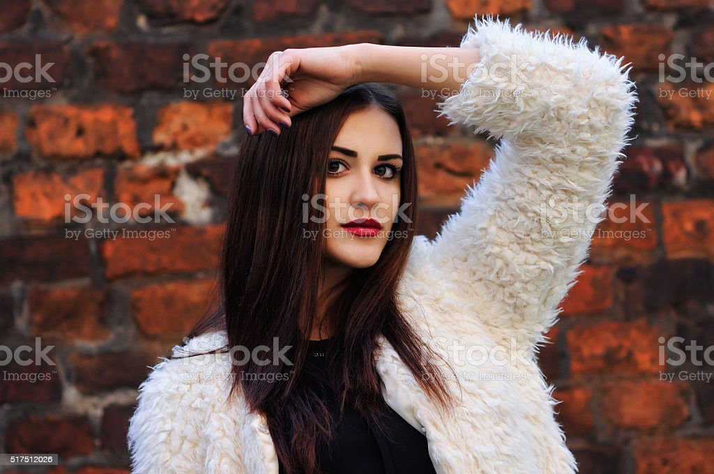 Outdoors portrait of beautiful young woman with big eyes stock photo