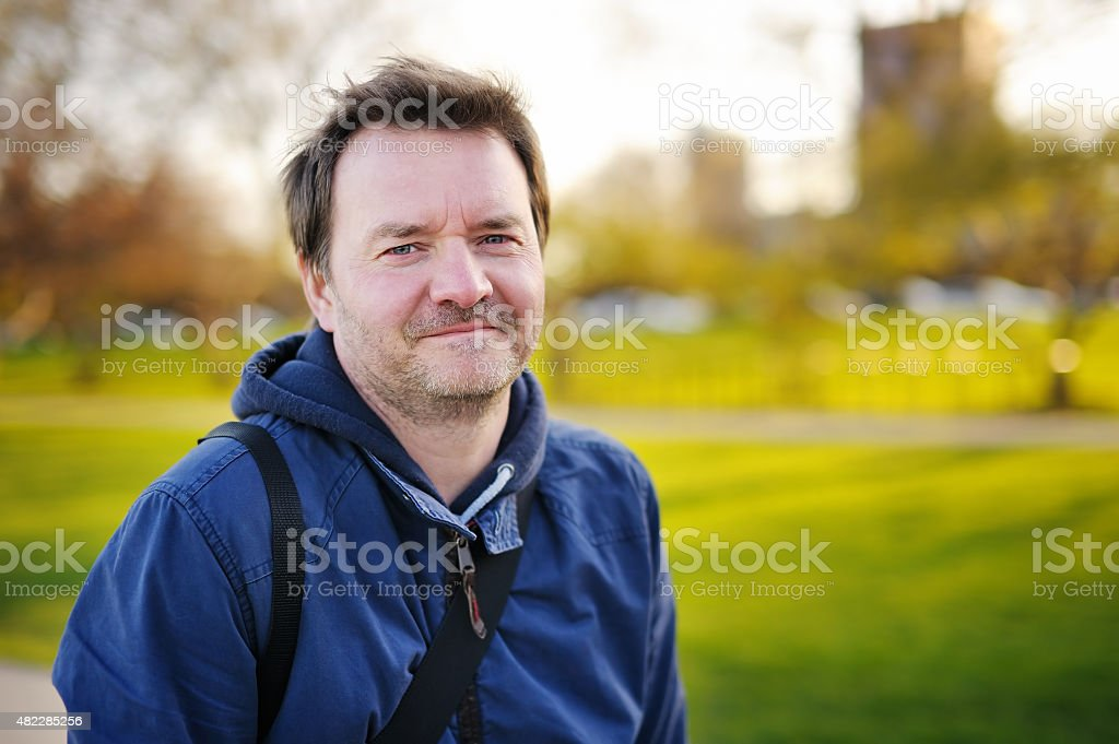 Outdoors portrait of middle age man stock photo
