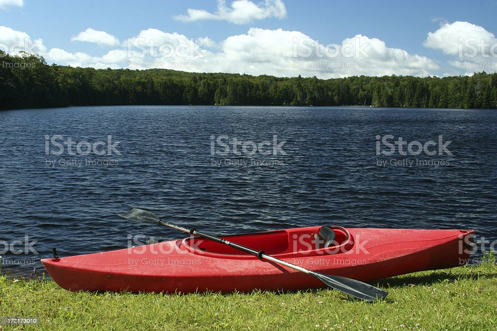 Outdoors red kayak canoe by mountain lake Vermont royalty-free stock photo