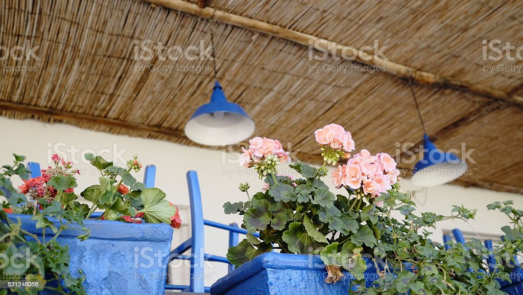 Outdoors seating area with flowers stock photo
