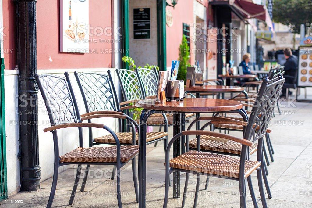 Outdoors street cafe tables stock photo
