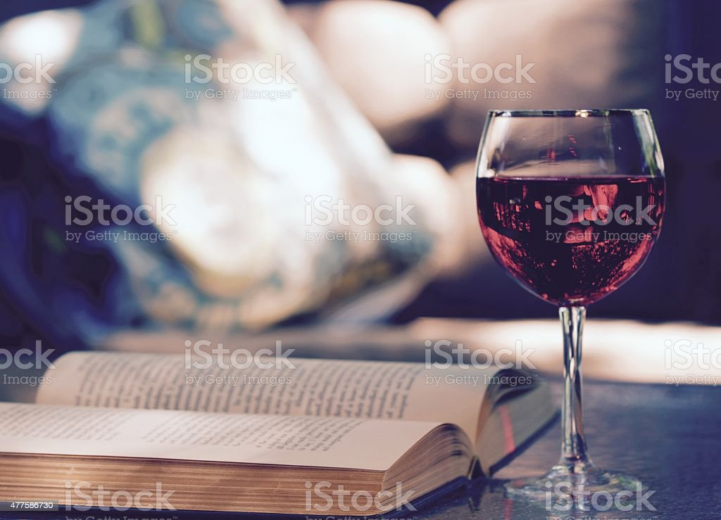 Outdoors with Wine and a book stock photo