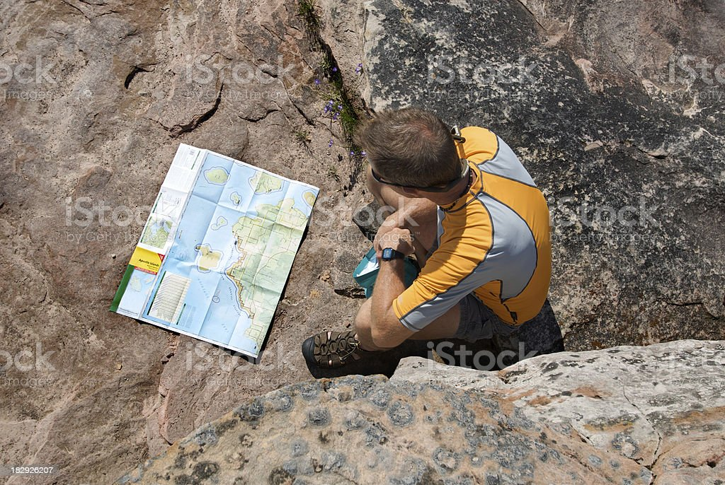 Outdoorsman Checking the Map royalty-free stock photo
