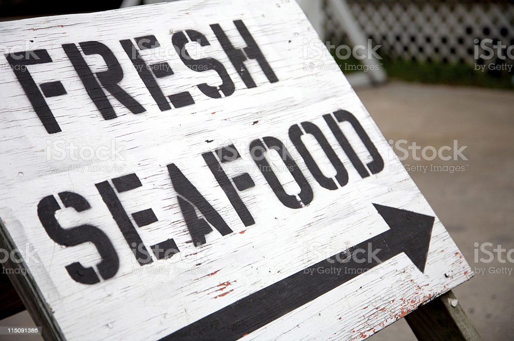 outer banks coastal sign fresh seafood stock photo