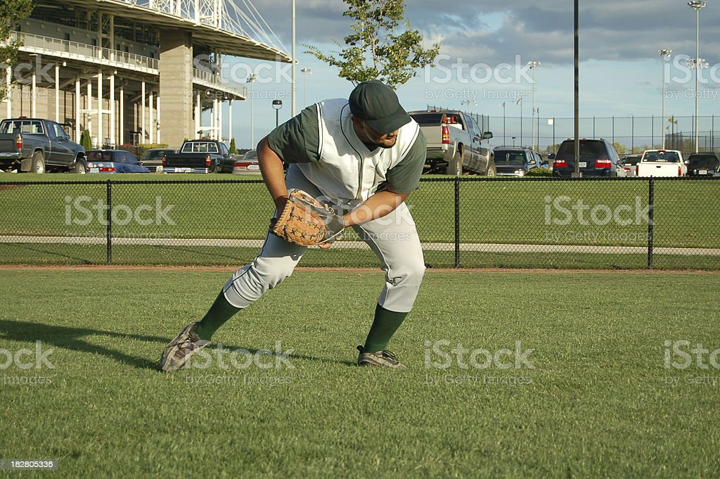 Outfielder Returns a Grounder royalty-free stock photo