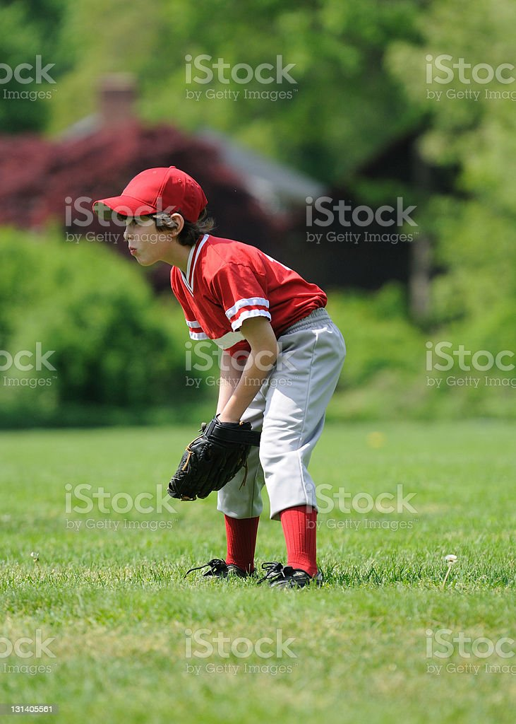 outfielder youth league boy stock photo