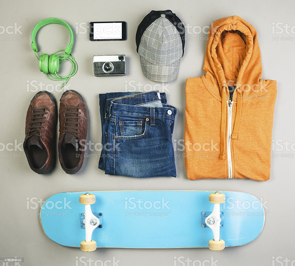 Outfit of skater man on grey background. stock photo