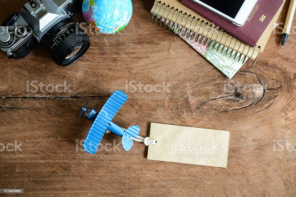 Outfit of traveler on wooden background and copy space, Vintage stock photo